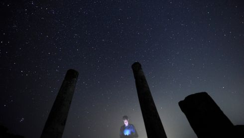 A photographer checks his camera during the Perseid meteor shower at Stobi archeological site, which was the largest city in the northern part of the Roman province of Macedonia. According to NASA, the annual Perseid meteor shower reaches its peak on August 12th and 13th in Europe. The fireballs from the meteorites are fast and plentiful, the agency adds, with as many as 100 visible in a single hour. Photograph: Ognen Teofilovski/Reuters