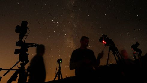 Photographers Shawn Kaye, Scott Meadows and Steve Gentry set their cameras to the stars during the Perseid meteor shower  north of Castaic Lake, California. Photograph: Gene Blevins/Reuters