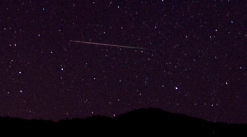 A meteor streaks over  Castaic Lake, California. Photograph: Gene Blevins/Reuters