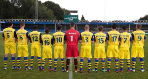 Farnborough players, with their new names on their shirts, pose for photos as part of the club's new sponsorship deal with Paddy Power. Photo: David Parry/PA