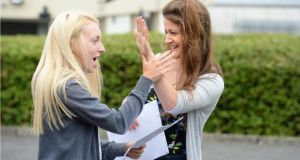 Siobhan Brady (left) and Sarah Hawkins with their leaving cert results at Portmarnock Community School, Portmarnock, Co Dublin. Photograph: Dara Mac Dónaill/The Irish Times.