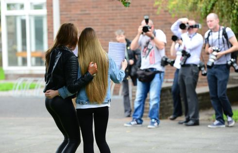 Nicole Collopy and friend Helena Lawless pose for photographers with their Leaving Cert exam results at Ringsend College in Dublin. Photograph: Bryan O'Brien/The Irish Times