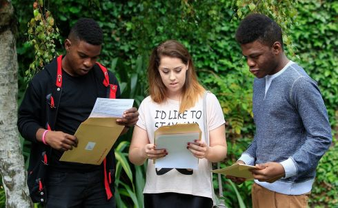 Students (left to right) Pacha Kitata, Melanie Smith and Samuel Sonowo get their Leaving Certificate results at Ringsend College, Dublin. Photograph: Julien Behal/PA Wire