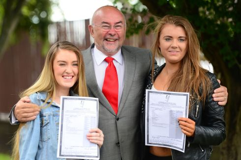 Nicole Collopy and friend Helena Lawless with  Minister for Education and Skill Ruairi Quinn who visited staff and students of Ringsend College in Dublin today as students received their Leaving Cert results. Photograph: Bryan O'Brien/The Irish Times