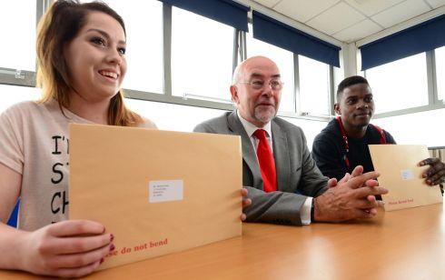 Minister for Education and Skills Ruairi Quinn with Leaving Cert students Melanie Smith and  Pacha Kitata at Ringsend College in Dublin.