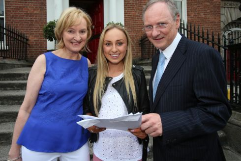 Caira Walsh celebrates the results of her  Leaving Certificate exams with her parents Marie and Michael  at Loreto College in Dublin. Photograph: Niall Carson/PA Wire