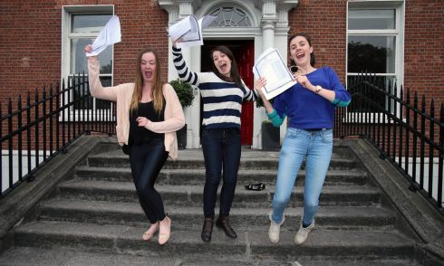 Robyn Kehoe, Sarah Boyce and Grainne Lowney celebrate at Lorett College in Dublin. Photograph: Niall Carson/PA Wire