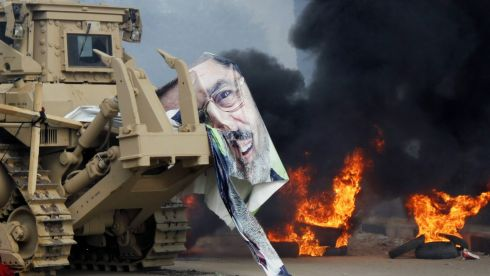 A torn poster of deposed Egyptian President Mohamed Morsi is caught on a military vehicle as riot police clear the area of his supporters at Rabaa Adawiya square, where the protesters had been camping, in Cairo. At least 95 Egyptians were killed in ongoing clashes. Photograph: Mohamed Abd El Ghany/Reuters