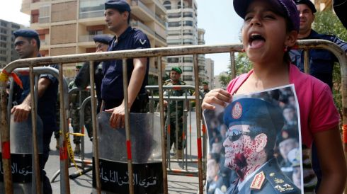 A girl carries a stained portrait of Egyptian army chief General Abdel Fattah al-Sissi and shouts anti-government slogans. Photograph: Mohamed Azakir/Reuters