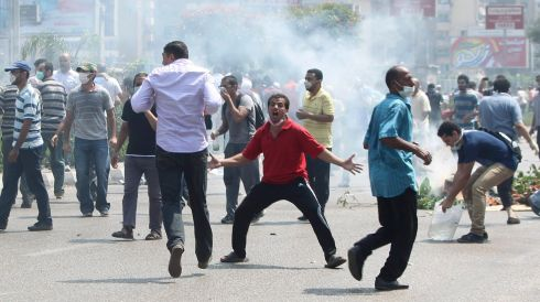 Protesters face off against the security forces around the area of Rabaa Adawiya square. Photograph: Asmaa Waguih/Reuters