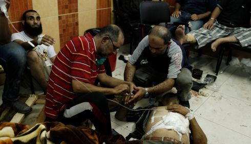 A wounded Morsi supporter is treated on the floor of the Rabaa al-Adaweya Medical Centre. Photograph: Ed Giles/Getty Images