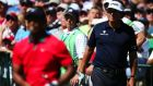 Phil Mickelson keeps an eye on Tiger Woods as he drives off in last weekend's US PGA Championship. Photograph: Andrew Redington/Getty Images