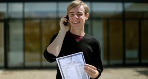 Mark Berney (19) at Gorey Community College, Co Wexford, holding a copy of his Leaving Cert results with 9 A1s. Photograph: Julien Behal/PA Wire