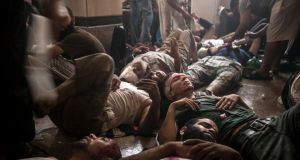Wounded supporters of  ousted president Mohammed Morsi at a field hospital following clashes with security forces in Cairo yesterday. Photograph: Narciso Contreras/the New York Times