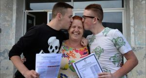 Suzanne Doyle happy for her twin sons, Nathan (left) and Jordan, who received their Leaving Cert results from St John's College, Ballyfermot. Photograph: Brenda Fitzsimons