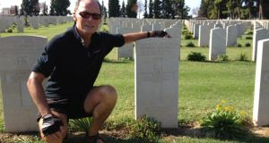 Michael Guilfoyle at his grandfather's grave in Thessaloniki