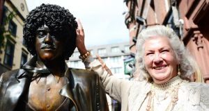The boy is back in town: Philomena Lynott   with the restored statue of her son Phil on Dublin's Harry Street. Photograph: Bryan O'Brien/The Irish Times