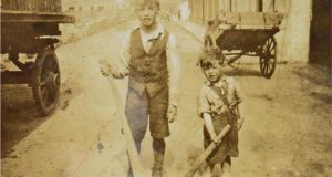 Joe Rock (on left) and his younger brother Christy with their hurleys on Love Lane, Ballybough, in Dublin in 1936