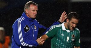 Northern Ireland Manager Michael O'Neill congratulates goal scorer Martin Patterson at Windsor Park. Photograph: Paul Faith/PA Wire