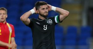 A frustrated Shane Long after missing another good opportunity for the Republic of Ireland. Photograph: Donall Farmer/Inpho