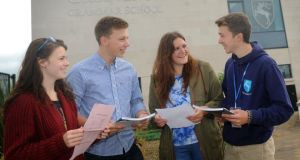 Emma Wallace, Jonathan McKeag , Sarah Robinson and Peter Mulligan at Grosvenor Grammar School in Belfast with their A-level results. Photographer: Colm Lenaghan/Pacemaker