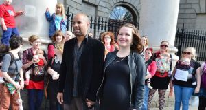Aja Teehan and her husband Charles Brand with their supporters outside the Four Courts. Photograph: Alan Betson/The Irish Times