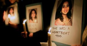 Telling the story: a vigil outside Leinster House, in Dublin, to remember Savita Halappanavar. Photograph: Julien Behal/PA Wire