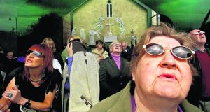 Telling the story: people watch for an apparition at Knock Shrine, in Co Mayo. Photograph:  Julien Behal/PA Wire