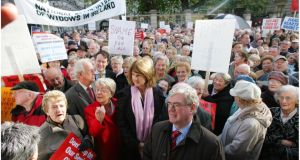 Joan Burton and Eamon Gilmore attend a protest against changes in medical card eligibility for the elderly in 2008. Photograph: Bryan O'Brien