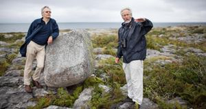 Fintan O'Toole and Gordon D'Arcy by a granite boulder during their walk along the Flaggy Shore near New Quay, Co Clare. Photograph: Eamon Ward