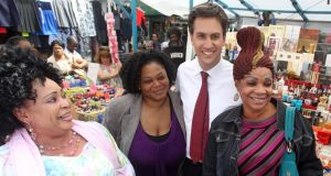 Ed Miliband campaigning in Walworth, south London. Labour is running at 10 points ahead of the Conservatives in the polls. Photograph: PA