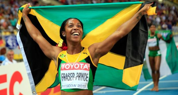 Shelly-Ann Fraser-Pryce of Jamaica celebrates winning gold in the Women's  200 metres