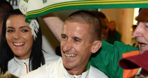 Rob Heffernan with his wife Marian at Dublin airport following his 50km walk victory in Moscow. Photograph: Frank Miller