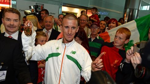 Rob Heffernan arriving home following his 50k Walk World Championship win in Moscow. Photograph: Frank Miller/The Irish Times