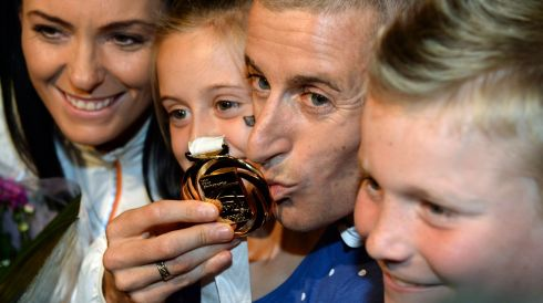 Rob Heffernan with his gold medal and his  wife Marian and children Meghan (8) and Cathal (6). Photograph: Frank Miller/The Irish Times