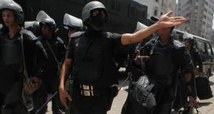 Heavily-armed members of  Egypt's security forces in Cairo. Photgraph: Amr Abdallah Dalsh/Reuters