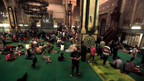 Demonstrators who support ousted Egyptian president Mohamed Morsi wait inside al-Fath mosque at Ramses Square in Cairo. Egyptian authorities rounded up more than 1,000 Islamists as the Muslim Brotherhood leadership defiantly called a week of nationwide protests. Photograph: Mohamed Abd El Ghany/Reuters