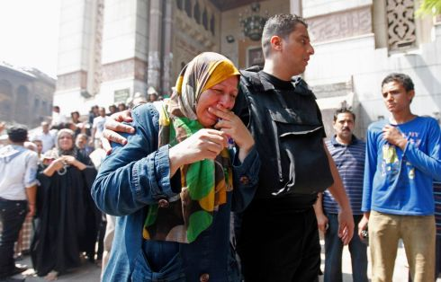 A police officer attempts to calm down the mother of a supporter of ousted Egyptian President Mohamed Morsi. Photograph: Mohamed Abd El Ghany/Reuters