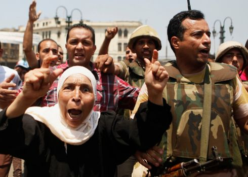 Supporters of the interim government installed by the army cheer soldiers near the al-Fath mosque on Ramses Square. Photograph: Amr Abdallah Dalsh/Reuters