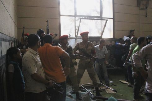 Soldiers inside a room of al-Fath mosque when supporters of deposed Egyptian President Mohamed Morsi exchanged gunfire with security forces. Photograph: Muhammad Hamed/Reuters