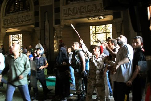 A member of the army points to the second floor of the mosque with a stick during clashes with supporters of Morsi. Photograph: Muhammad Hamed/Reuters