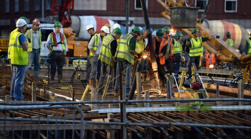 Pouring the concrete on Friday night for the new Luas bridge over the river Liffey between O'Connell Bridge and Butt Bridge. Photograph: Frank Miller/The Irish Times