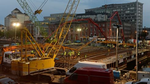 Building workers and engineers at the scene on Friday night at the pouring of concrete for the new Luas bridge over the river Liffey between O'Connell Bridge and Butt Bridge. Photograph: Frank Miller/The Irish Times