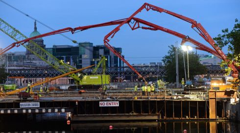 The scene on Friday night at the pouring of concrete for the new Luas bridge over the river Liffey between O'Connell Bridge and Butt Bridge. Photograph: Frank Miller / THE IRISH TIMES