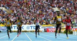 (l-r) Anaso Jobodwana of South Africa, Nickel Ashmeade of Jamaica, Adam Gemili of Great Britain, Usain Bolt of Jamaica and Curtis Mitchell of the United States compete in the Men's 200m final in Moscow. Photograph:  Jamie Squire/Getty Images