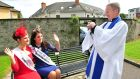 Lay reader David Tough takes a picture of Donegal Rose Catherine McCarron and 2012 Rose of Tralee Nicola McEvoy after morning service at St. John's Church, Tralee, Co Kerry, yesterday. Photograph: Domnick Walsh/Eye Focus