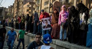 Supporters of Mohammed Morsi, the ousted Egyptian president, wait for the Metro in the Maadi neighborhood to travel closer to Cairo city centre to continue their demonstration yesterday. Photograph: Bryan Denton/The New York Times