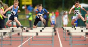 Max Corcoran, Co Limerick, Dillion Ryan,  Co ipperary and Oisin Doyle, Co Carlow, compete in the U10 Boys 60 metre Hurdles Final. Photograph: David Maher / Sportsfile