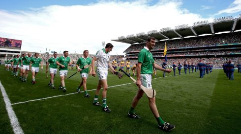Limerick's Donal O'Grady leads his team out during the parade. Photo:Ryan Byrne/Inpho