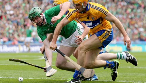 Clare's Colm Galvin and Cian Dillon with Declan Hannon of Limerick in action. Photograph:James Crombie/Inpho